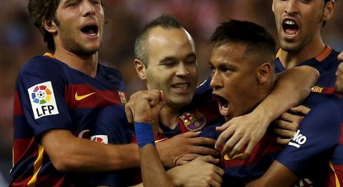 Barcelona's Neymar (C) celebrates with team mates after scoring a goal against Las Palmas during their Spanish first division soccer match at Vicente Calderon stadium in Madrid, September 12, 2015.  REUTERS/Javier Barbancho