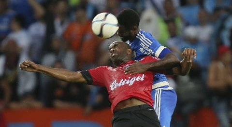 Guingamp's forward Sloan Privat, front, jumps for a header with Marseille's defender Nicolas Nkoulou during their French League One soccer match against Guingamp at the Roudourou stadium in Guingamp, western France, Friday, Aug. 28, 2015. Guingamp defeated Marseille 2-0. (AP Photo/David Vincent)
