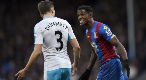 "Football - Crystal Palace v Newcastle United - Barclays Premier League - Selhurst Park - 28/11/15 Crystal Palace's Wilfried Zaha remonstrates with Newcastle's Paul Dummett Action Images via Reuters / Adam Holt Livepic EDITORIAL USE ONLY. No use with unauthorized audio, video, data, fixture lists, club/league logos or ""live"" services. Online in-match use limited to 45 images, no video emulation. No use in betting, games or single club/league/player publications.  Please contact your account representative for further details."