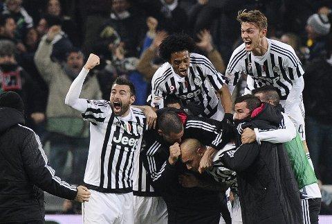 Juventus-spillerne jubler etter seieren mot Napoli forrige helg. Vår oddstipper tror de får en ny seier å feire i kveld.