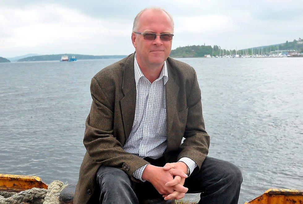 Havnedirektør Finn Flogstad har grunn til å smile etter at de har fått lån i Kommunalbanken.