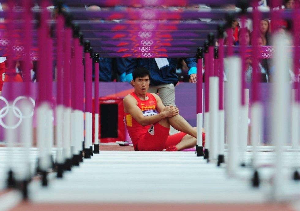 Du store kineser for en nedtur. Hekkestjernen Xiang Liu misset OL på hjemmebane på grunn av skade, mens han snublet ut av London-OL allerede på første hekk.  (Foto: Stu Forster, Getty Images/All Over Press/ANB)