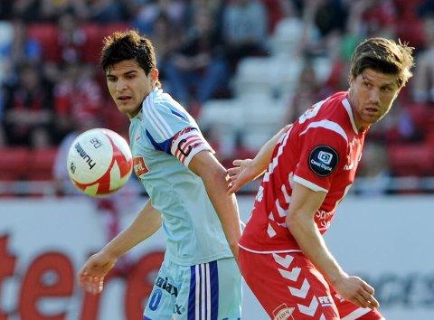 Tarik Elyounoussi  og Branns Erik Mjelde på Brann stadion.