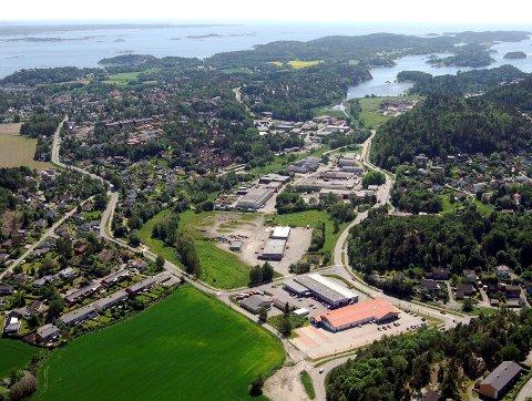 Området sørøst for Rema 1000 og bilforretningen ved Heimdal kan komme til å romme innpå 100 nye boliger.