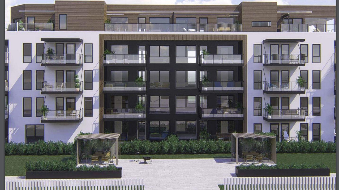 Bygger blokk og P-hus med park på taket