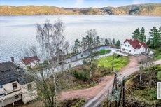 NESBYGDA - Tomt beliggende med flott utsikt rett ved kommunegrensen til Drammen.