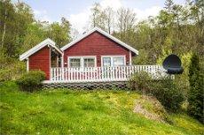 Åserød - Fritt beliggende hytte med utsikt og båtfeste.