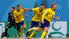 Sweden's Emil Forsberg, right, celebrates with teammates after scoring the opening goal during the round of 16 match between Switzerland and Sweden at the 2018 soccer World Cup in the St. Petersburg Stadium, in St. Petersburg, Russia, Tuesday, July 3, 2018. (AP Photo/Darko Bandic)