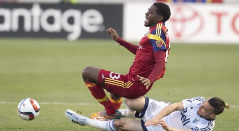 Apr 18, 2015; Sandy, UT, USA; Real Salt Lake forward Olmes Garcia (13) is fouled by Vancouver Whitecaps FC midfielder Russell Teibert (31) during the first half at Rio Tinto Stadium. Mandatory Credit: Russ Isabella-USA TODAY Sports