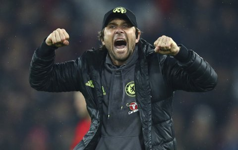 Chelsea's manager Antonio Conte celebrates at the final whistle of the English Premier League soccer match between Liverpool and Chelsea at Anfield stadium in Liverpool, England, Tuesday, Jan. 31, 2017. (AP Photo/Dave Thompson)