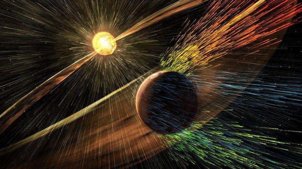 En NASA-illustrasjon som viser hvordan en solstorm river partikler ut av Mars-atmosfæren. Nye data fra romsonden MAVEN har gitt forskerne ny innsikt i hvordan planeten mistet sin fuktige, tykke atmosfære, og NASA la fram funnene torsdag.