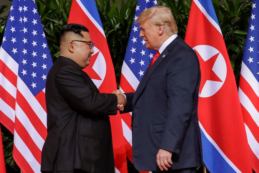 KIM & DONALD: Yippie! (AP Photo/Evan Vucci)