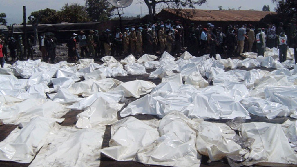 "UN Peacekeepers and medics stand beside the bagged bodies of victims of an oil tanker explosion in Sange, Democratic Republic of Congo on July 3, 2010. Excitement turned to horror for football fans gathered to watch the World Cup, as they were among hundreds killed in a fire from a fuel truck explosion in Democratic Republic of Congo. ""People tried to escape but were caught by the fire and reduced to ashes,"" one local said of the disaster that happened when a fuel truck overturned and exploded in Sange, a small town of some 50,000 people in eastern DR Congo."