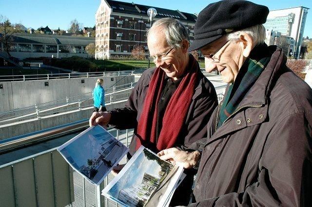 Håvard Hegna og Nils Roll-Hansen ber politikere og utbyggere huske på at Nydalen skal forbli et attraktivt boligområde. Her med de vedtatte forslagene til utbygging av Nydalsveien (i bakgrunnen).