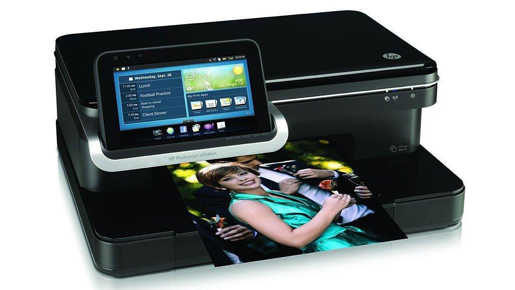 Den avtagbare skjermen på HP Photosmart eStation kan brukes som et nettbrett for sofasurfing.