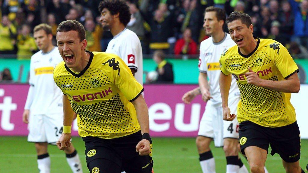 Ivan Perisic (L) of Dortmund celebrates after he heads his team's leading goal during the Bundesliga match between Borussia Dortmund and Borussia Moenchengladbach.