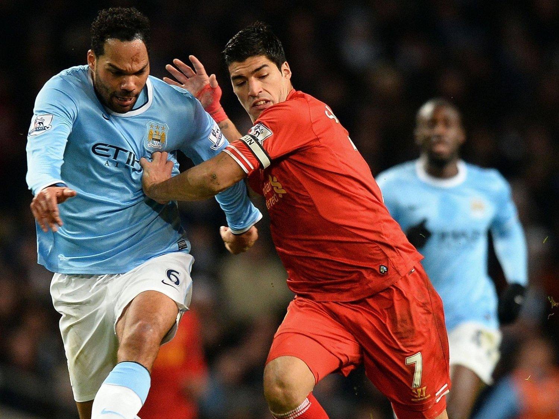 TOPPKAMP: Luis Suarez og Liverpool møter Manchester City til gullkamp på Anfield søndag ettermiddag.