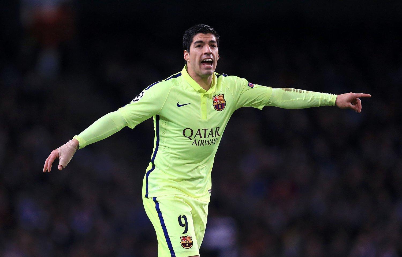 TAKK FOR SIST: Luis Suarez scoret to i møtet med Manchester City.