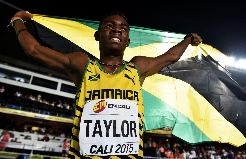 REKORDGUTTEN: 15 år gamle Christopher Taylor feirer seieren på 400m i U18-VM i Cali i Colombia natt til lørdag norsk tid. Vinnertiden er ny verdensrekord for 15-åringer og ny juniorrekord i Jamaica.