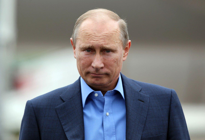 Russiske myndigheter raste da ledende byråer tidligere i år nedgraderte Russlands kredittverdighet til såkalt søppelstatus. Bildet viser Russlands president Vladimir Putin i juli.